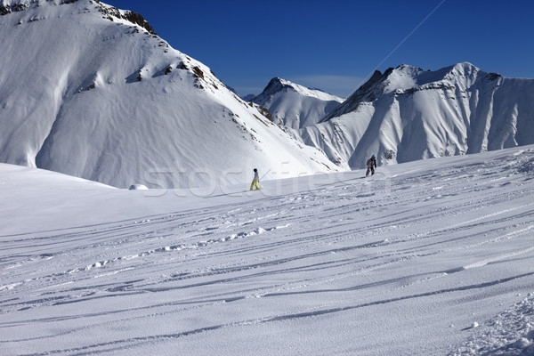 Snowboarders downhill on off piste slope with newly-fallen snow Stock photo © BSANI