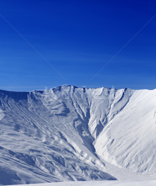 Off-piste slope with traces of avalanche in sun morning Stock photo © BSANI