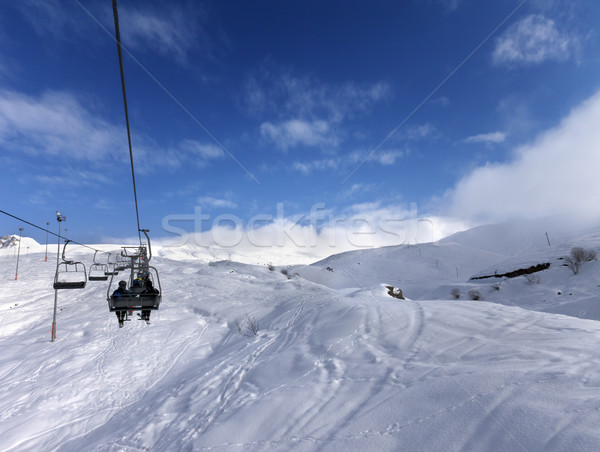 Chair-lift and off-piste slope in wind day Stock photo © BSANI