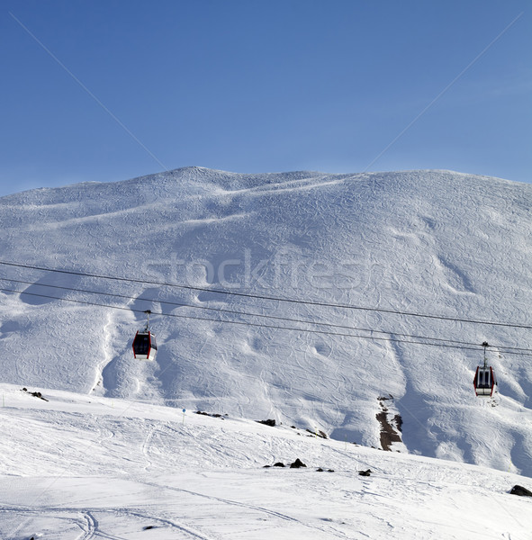 Gondola lifts and ski slope at nice sun morning Stock photo © BSANI