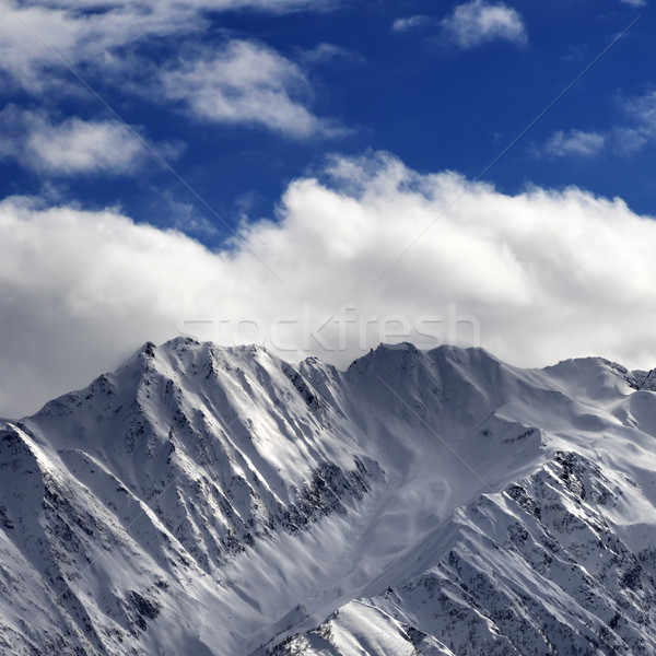 Snow winter mountains and sunlight cloud sky in evening Stock photo © BSANI