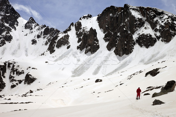 Hiker in snow mountain with trace from avalanches at sun spring  Stock photo © BSANI