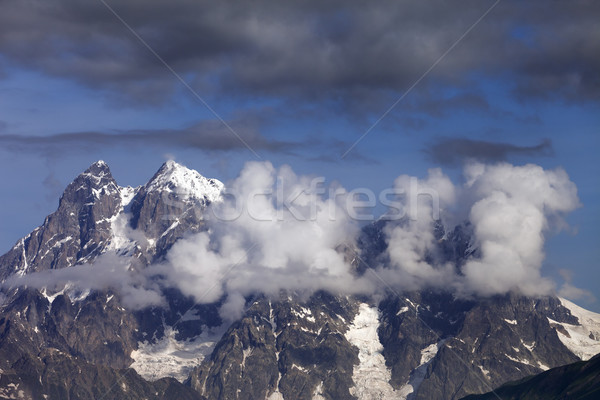 Mt. Ushba in clouds, Caucasus Mountains, Georgia, Svaneti. Stock photo © BSANI
