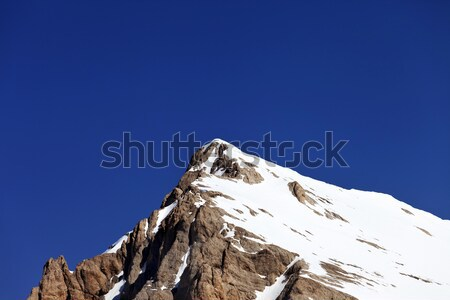 Mountain top with snow and cloudless blue sky in nice day Stock photo © BSANI