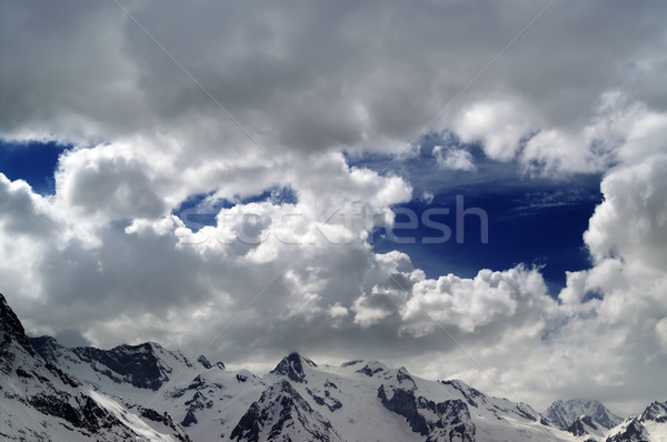 Snowy mountains in beautiful clouds Stock photo © BSANI