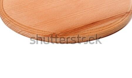 Round wooden kitchen board on white background Stock photo © BSANI