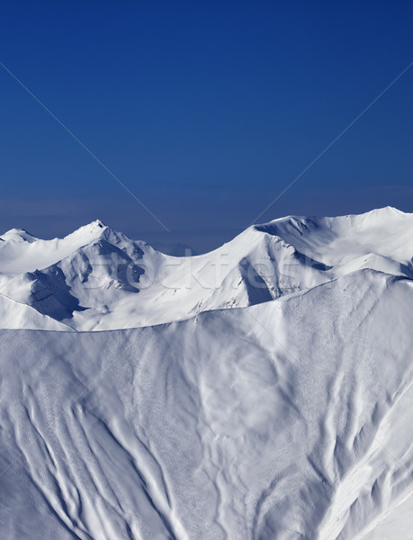 Off-piste slope with traces of skis and snowboards in sun day Stock photo © BSANI