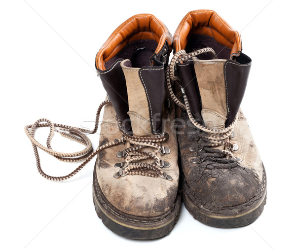 Pair of old dirty trekking boots Stock photo © BSANI