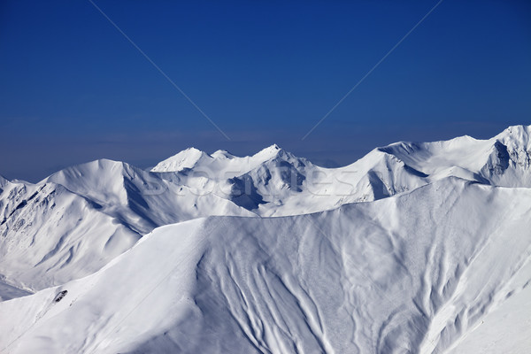Off-piste slope with traces of skis and snowboards in nice day Stock photo © BSANI