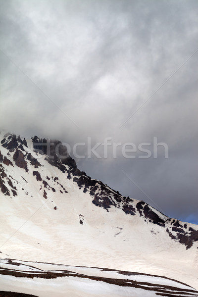 Snowy mountains in storm clouds Stock photo © BSANI