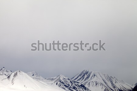 Gray snowy mountains in mist Stock photo © BSANI