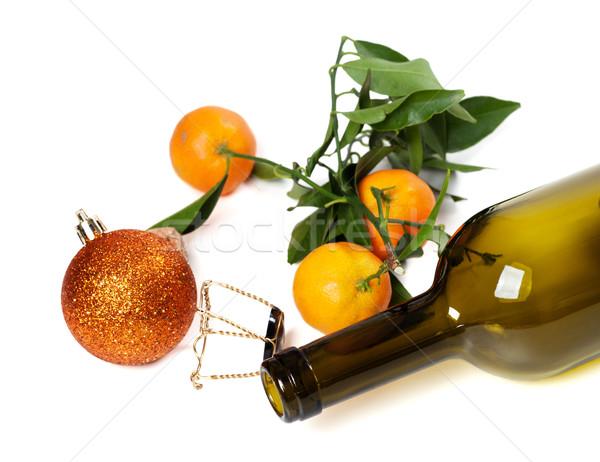 Empty bottle of wine, muselet, mandarins and Christmas decoratio Stock photo © BSANI