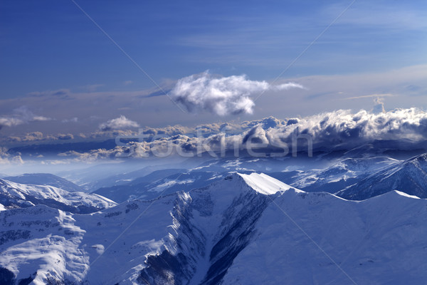 Stock photo: Winter mountains at evening and sunlight clouds