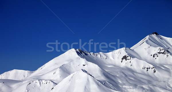Panoramic view on snowy winter mountains and clear blue sky in s Stock photo © BSANI