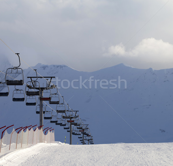 Stock photo: Snow skiing piste and ropeway at evening