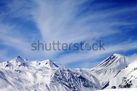 Winter snowy mountains at sun windy day Stock photo © BSANI