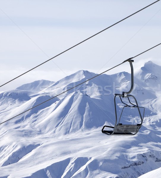 Stock photo: Chair lifts and off piste slope in fog