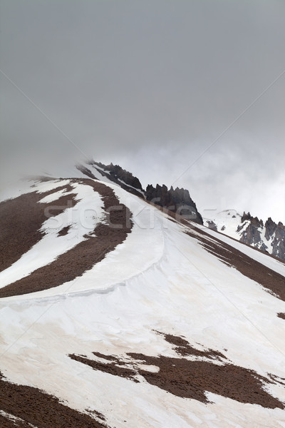 Snowy mountains before rain Stock photo © BSANI