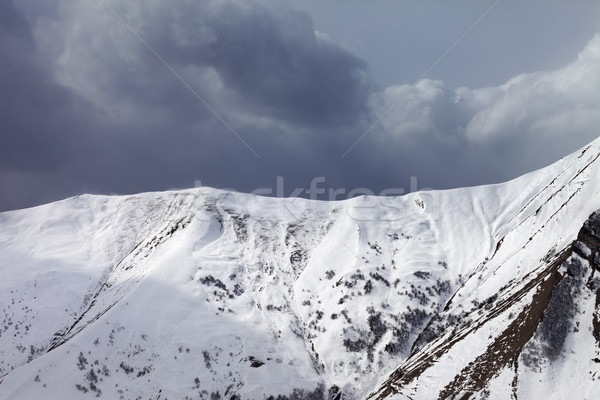 Snowy mountains and overcast sky Stock photo © BSANI