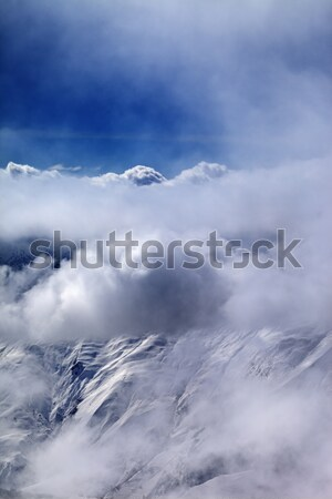 View on off-piste slope at mist and sunlight clouds Stock photo © BSANI