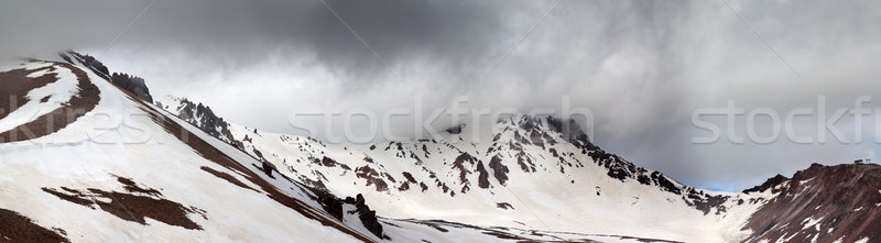 Stock photo: Panorama of snowy mountains before rain