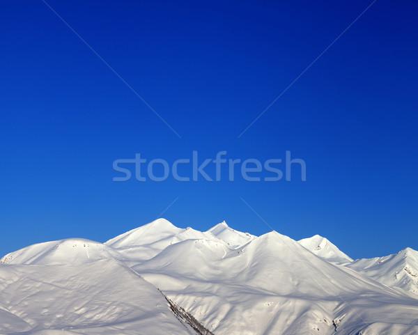 Snowy mountains and blue clear sky  in morning Stock photo © BSANI