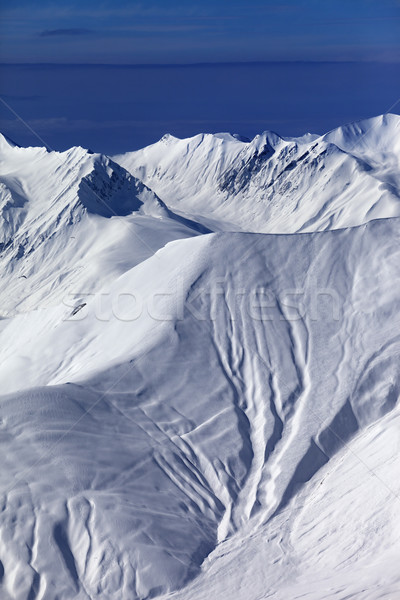 View on off-piste snowy slope at nice evening Stock photo © BSANI