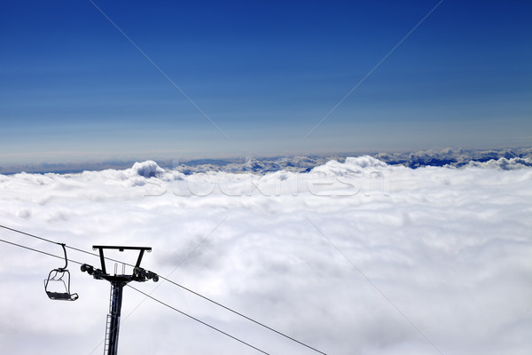 Mountains under clouds and chair-lift Stock photo © BSANI