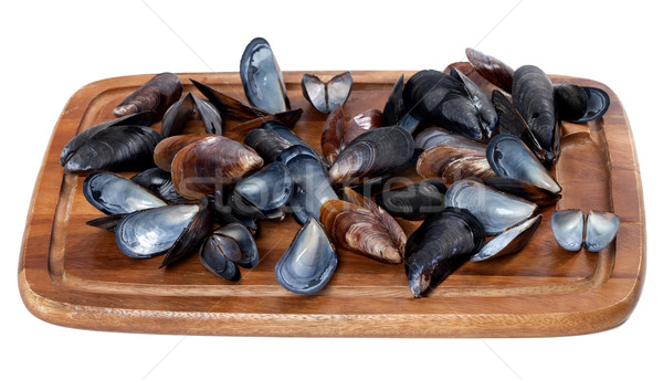 Stock photo: Shells of mussels on wooden board