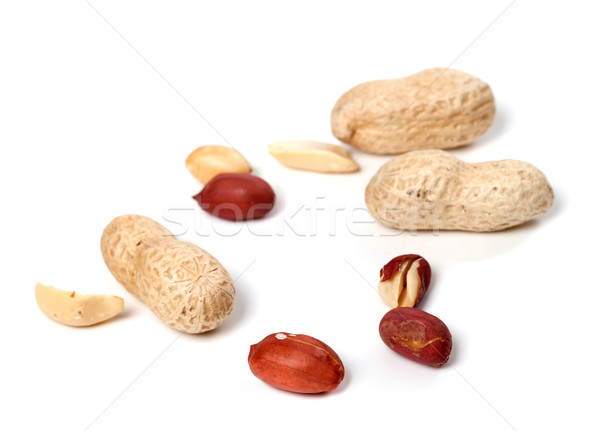 Peanuts on white background Stock photo © BSANI