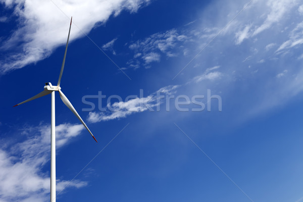 Wind turbine and blue sky with clouds Stock photo © BSANI