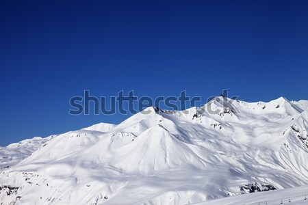 Panoramic view on snowy mountains at sun day Stock photo © BSANI