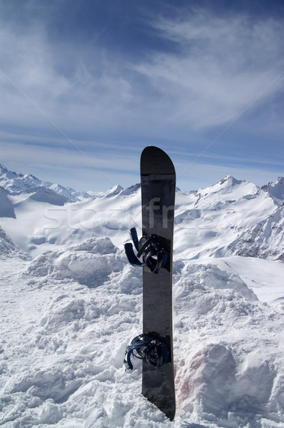 Snowboard against the hight mountains Stock photo © BSANI