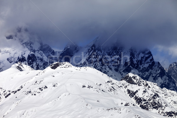 Snowy rocks in haze and storm clouds before blizzard Stock photo © BSANI