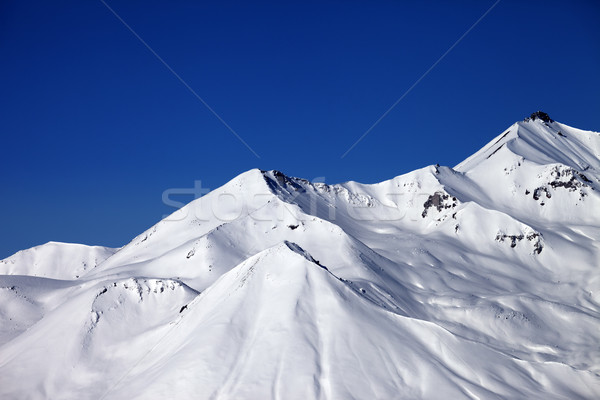 Snowy winter mountains and clear blue sky in sun day Stock photo © BSANI