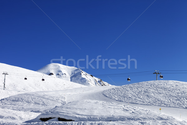 Gondola lift and ski slope at nice day Stock photo © BSANI