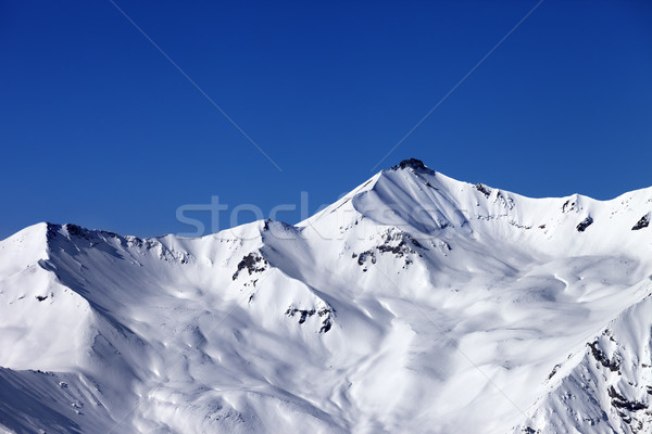 Off-piste snowy slope and blue clear sky Stock photo © BSANI