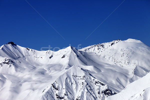 Off piste snowy slope and blue clear sky Stock photo © BSANI