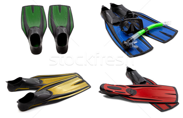 Set of multicolored swim fins, masks, snorkel for diving with wa Stock photo © BSANI