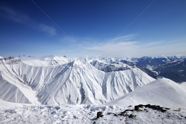 Snowy mountains at sun day Stock photo © BSANI