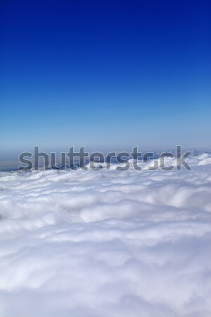 Mountains under clouds and clear blue sky Stock photo © BSANI