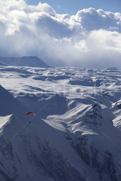 Speed flying in snow mountains Stock photo © BSANI