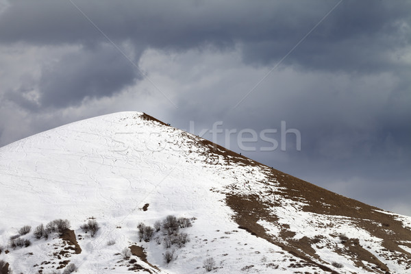 Stock photo: Off piste slope and overcast gray sky