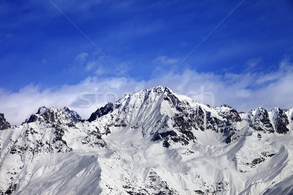 Snow mountains in winter sun day and blue sky with clouds Stock photo © BSANI