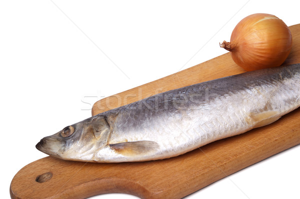 Herring and onion on kitchen board Stock photo © BSANI