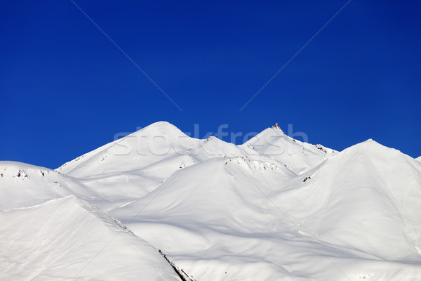 Snow-white mountains and blue sky Stock photo © BSANI