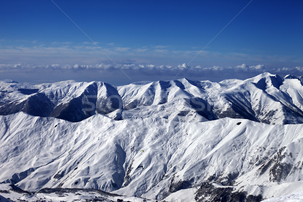Snowy mountains and sky with clouds Stock photo © BSANI
