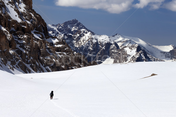 Hiker in snowy mountains Stock photo © BSANI