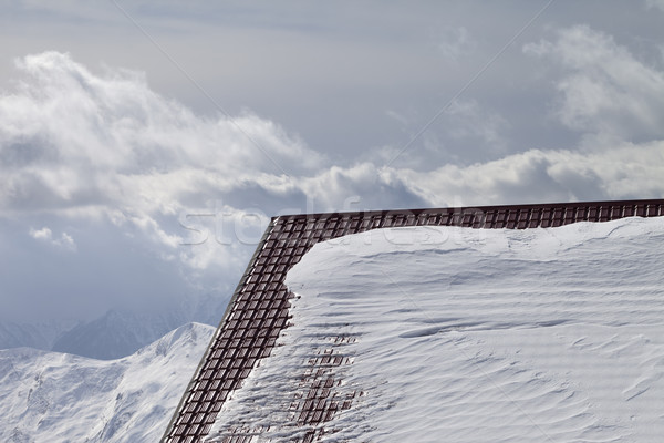 Roof of hotel in snow and winter mountains Stock photo © BSANI