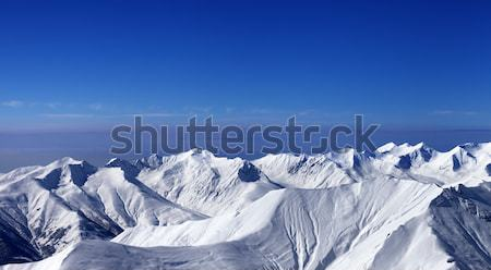 Panoramic view on off-piste slopes and multicolor blue sky at ni Stock photo © BSANI